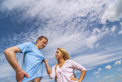 Girl is showing direction, guy is listening Stock Photos