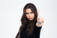 Girl showing disagree sign with finger Stock Photos