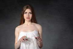 Girl showing disgust against a dark background Royalty Free Stock Photo