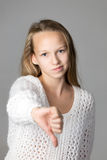 Girl showing dislike sign Royalty Free Stock Images