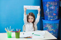 Girl Showing Drawing In Classroom Stock Photo