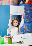Girl Showing Drawing Paper In Art Class Royalty Free Stock Photography