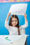 Girl Showing Drawing Paper In Preschool Royalty Free Stock Images