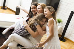 Girl showing a drawing to the mother. Girls showing a drawing to the mother at home royalty free stock images