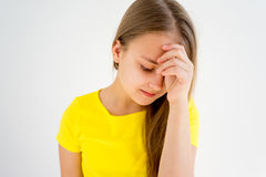 Girl showing emotions. A portrait of a girl showing different emotions royalty free stock image