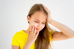Girl showing emotions. A portrait of a girl showing different emotions royalty free stock images