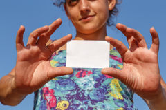 Girl showing an empty card. Girl showing an empty white card Stock Photography
