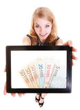 Girl showing euro money banknotes on tablet. Royalty Free Stock Image