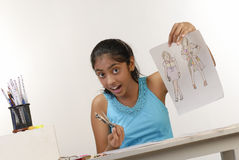 Girl showing fashion sketches Stock Photography