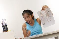 Girl showing fashion sketches. Beautiful girl showing fashion sketch Stock Photography
