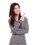 Girl showing finger on a blank space Stock Image
