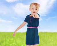 Girl showing forefinger aside Stock Photos