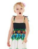 Girl showing forefinger aside Royalty Free Stock Photo