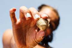 Girl Showing Founded Shell of Mussle Stock Image