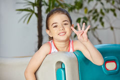 Girl showing four fingers of her Stock Photography