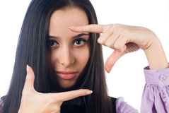 Girl showing frame sign Stock Photo