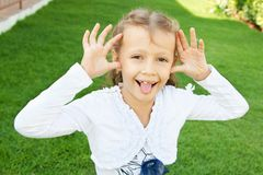 Girl showing funny faces Royalty Free Stock Image