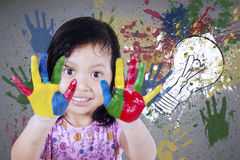 Girl showing hands painted with watercolor Royalty Free Stock Photos