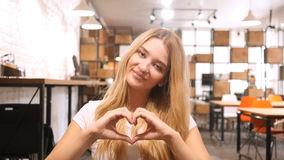Girl Showing Heart Made By Hands royalty free stock photos