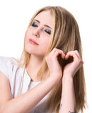 Girl  showing heart shape with hands Stock Photography