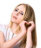 Girl  showing heart shape with hands Stock Photo
