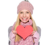Girl  showing heart shaped postcard Royalty Free Stock Photos