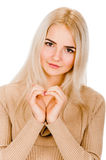 Girl showing heart symbol Royalty Free Stock Image