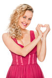 Girl showing heart symbol Stock Photography