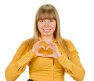 Girl showing heart symbol Royalty Free Stock Photos