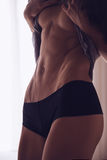 Girl showing her abs Stock Image