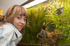 Girl showing her aquarium Royalty Free Stock Images