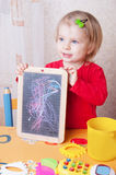 Girl showing her chalkboard drawings Royalty Free Stock Photo