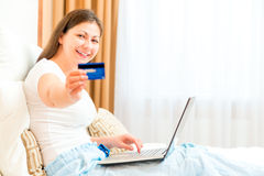 Girl showing her credit card Stock Image