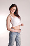 Girl showing her diet results Royalty Free Stock Images