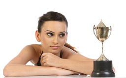 Girl showing her gold trophy Royalty Free Stock Photography