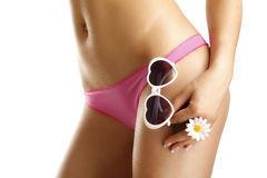Girl showing her hips  wearing bikini and sunglasses Royalty Free Stock Photo