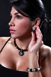 Girl showing her jewelry Stock Photography