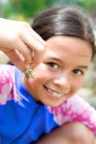 Girl showing her little hermit crab Stock Photos