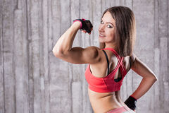 Girl showing her muscles Royalty Free Stock Photo