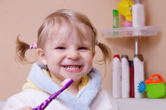 Girl showing her teeth in bathroom Royalty Free Stock Images