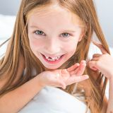 Girl showing her teeth Royalty Free Stock Photos