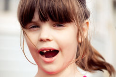 Girl showing her teeth Stock Photos