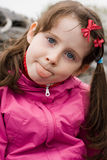 Girl showing her tongue Stock Image