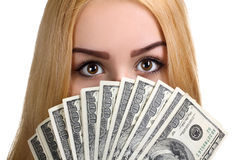 Girl. Showing hundred dollar bills spread out like a fan isolated on white background Royalty Free Stock Photos
