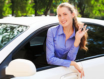 Girl showing the key of her new car Stock Images