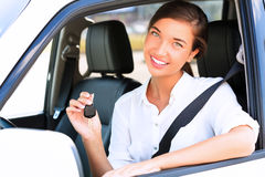 Girl showing the key of her new car Stock Photos