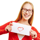 Girl showing love letter with red heart Royalty Free Stock Photo
