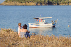 Girl Showing Mother Boat Stock Photography