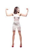 Girl showing muscles. Brunette girl showing her muscles Royalty Free Stock Photos