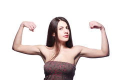 Girl showing muscles. Brunette girl showing her muscles Stock Photos